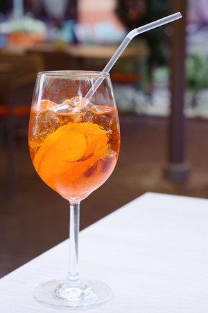 One glass of spritz aperol cocktail with orange slices Stock Photo