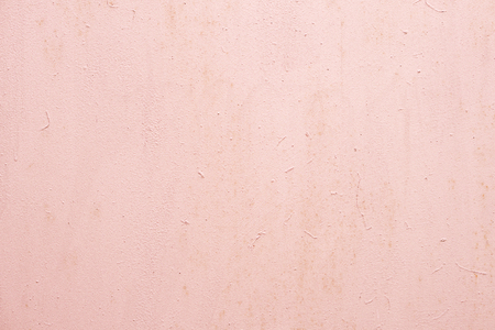 Light pink painted wall with rough texture plaster background