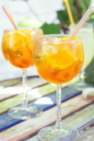 spritz: Two glasses of spritz aperol cocktail with orange slices, blurred background
