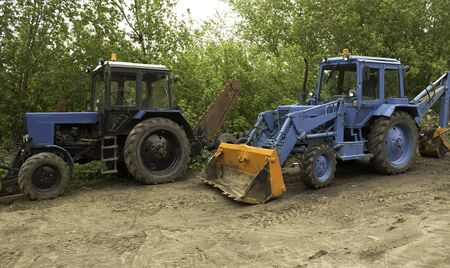 attachments: two blue tractors with various attachments