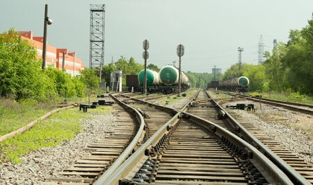 railway points: railway arrow, wagons and tanks are on the roads