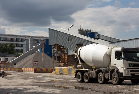 Cement Plant,Concrete or cement factory, white cement mixer in the foreground Standard-Bild