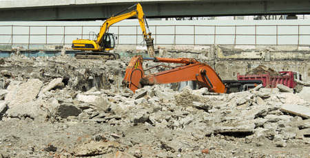 two excavators and dump truck at a construction site