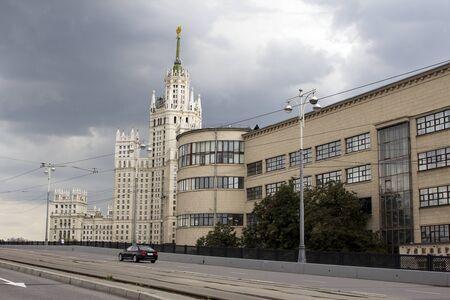 kotelnicheskaya embankment: Kotelnicheskaya Embankment Building. car rides through the streets on a background of a skyscraper Stock Photo