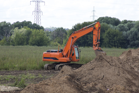 site preparation: excavator in the field. construction site preparation Stock Photo