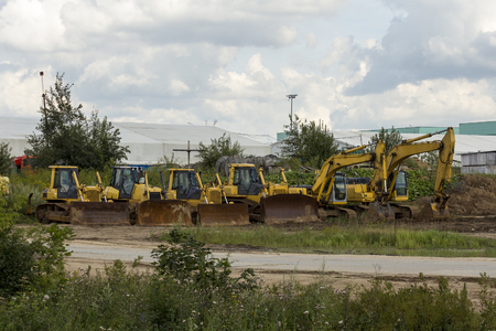 bulldozers: construction equipment, bulldozers and excavators at the site