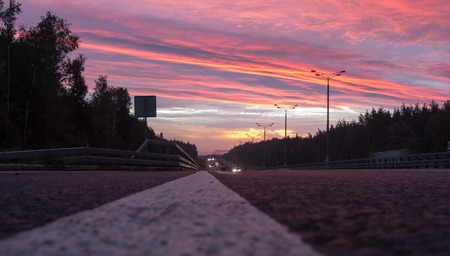 glows: speed highway at dawn. the sky glows in the light of dawn