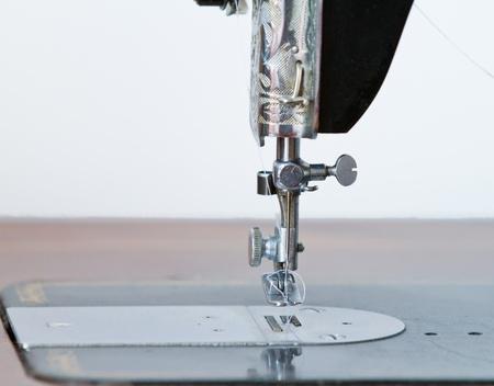 Antique sewing machine needle photo