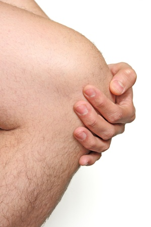 body pain: male knee with hand Stock Photo