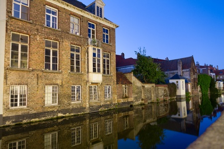 canal and houses at Bruges, Belgium photo
