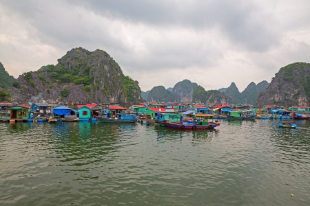 Floating fishing village halong bay, Vietnam, Asia photo