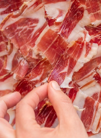 Picking serrano ham photo