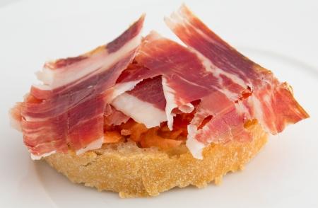 Spanish tapa, ham and tomato Stockfoto