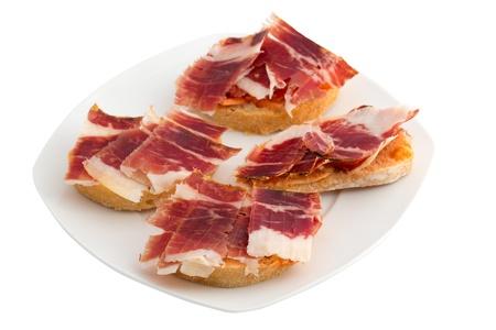 Spanish tapas, ham and tomato Stockfoto