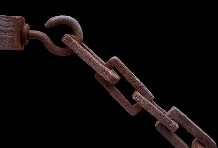 rusty chain: Rusty chain over black