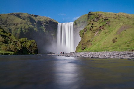 skogafoss waterfall: Long exposure of skogafoss waterfall and tourists on the South of Iceland near the town Skogar