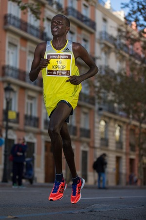VALENCIA - NOVEMBER 17: Kiprop (number 16) participates in Valencias marathon on November 17, 2013 in Valencia, Spain