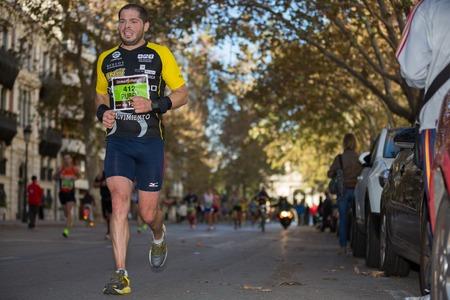 ruiz: VALENCIA - NOVEMBER 17: Ruben Ruiz Crespo (number 412) runner participates in Valencias marathon on November 17, 2013 in Valencia, Spain