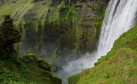 Middle height view of skogafoss waterfall on the South of Iceland near the town Skogar photo