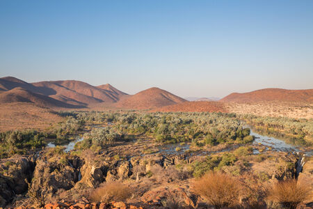 Wide view of Epupa waterfalls in summer time, the border of Angola and Namibia photo