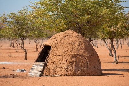 dwell house: Closeup of entrance of traditional hut of himba people in Namibia