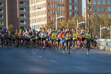 VALENCIA - NOVEMBER 17: Kemboi (number 3) leads the group with other runners at first meters of the marathon, in Valencias marathon on November 17, 2013 in Valencia, Spain