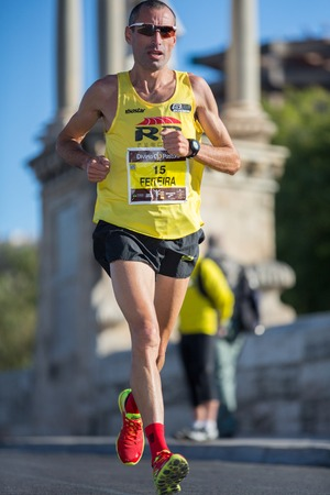 VALENCIA - NOVEMBER 17: Luis Feiteira (number 15) participates in Valencias marathon on November 17, 2013 in Valencia, Spain