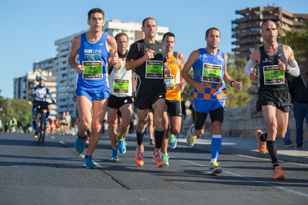 VALENCIA - NOVEMBER 17: Julian, Ismael, Endi and Alos lead their group during their participation in Valencias marathon on November 17, 2013 in Valencia, Spain