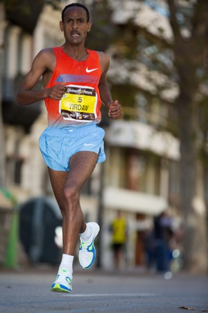 VALENCIA - NOVEMBER 17: Dejene Yirdaw (number 5) participates in Valencias marathon on November 17, 2013 in Valencia, Spain