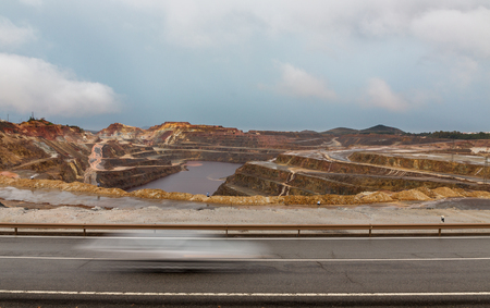 Copper mine open pit in Rio Tinto and car trail, Spain photo
