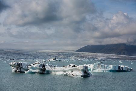 jokulsarlon: Wide view of blue icebergs floating in Jokulsarlon glacial lagoon, Iceland Stock Photo