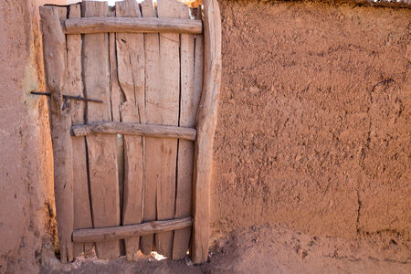 adobe wall: Closeup of old wooden door and adobe wall