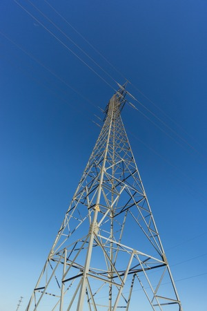 Entire electric tower ultra wide angle view over blue sky photo