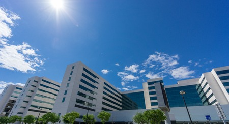 against the sun: Ultra wide angle of office building against sun