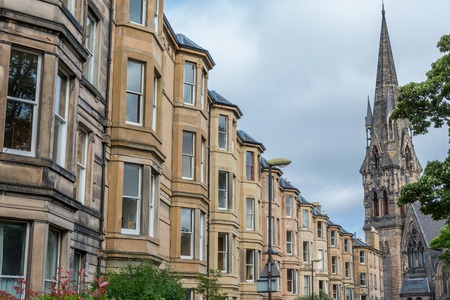 wide angle: Wide angle view of vintage facades and church in Edinburgh Stock Photo