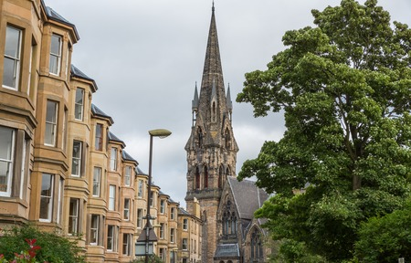 wide angle: Wide angle view of vintage facades and St Johns Tolbooth Church in Edinburgh