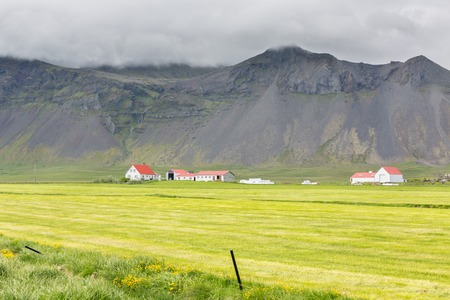 Farms and Mountains in Iceland photo
