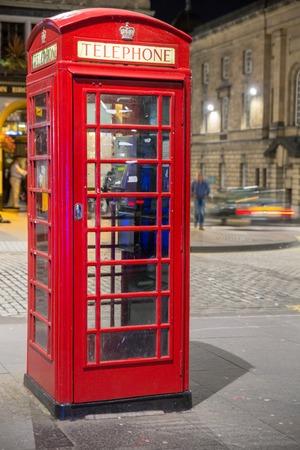 Classic red British telephone box, night scene Stock Photo