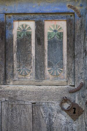 view of a wooden doorway: Old wooden door and lock
