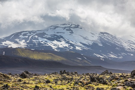 cloudy sky: Icelandic volcano with snow and cloudy sky Stock Photo