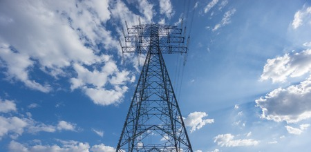 centered: Centered Electric tower over blue sky and clouds