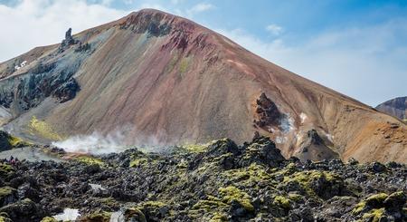 unbelievable: Tourists in Landmannalaugar unbelievable lava landscape, Iceland Stock Photo