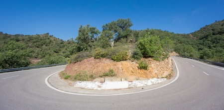 Ultra wide angle view of mountain hairpin bend curved\ road