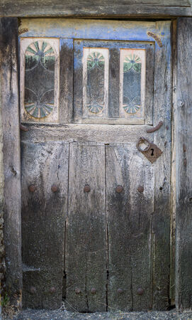old wooden door: Entire old wooden door and lock Stock Photo