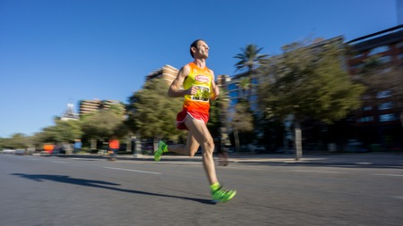 ultra: Marathon runner ultra wide angle side view