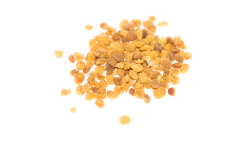 Top view of bee pollen against bright white background photo
