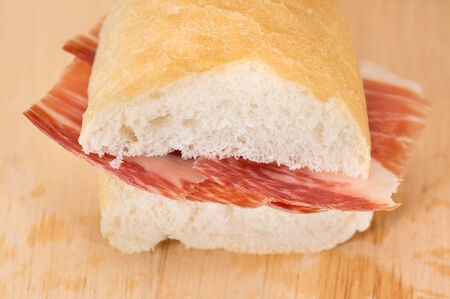 front view: Front view of Serrano ham sandwich over wood