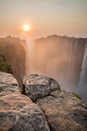 Victoria Falls sunset from Zambia side, rocks in the foreground photo