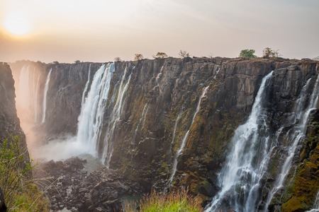 red sun: Victoria Falls sunset from Zambia side, red sun