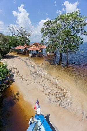 neglected: Beach with neglected cabins in the middle of Rio Negro, Brazil